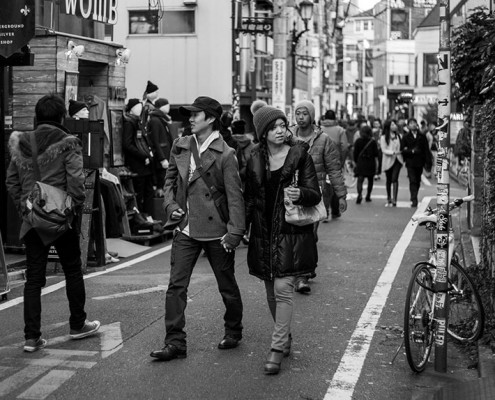 A couple wandering the streets of Harajuku