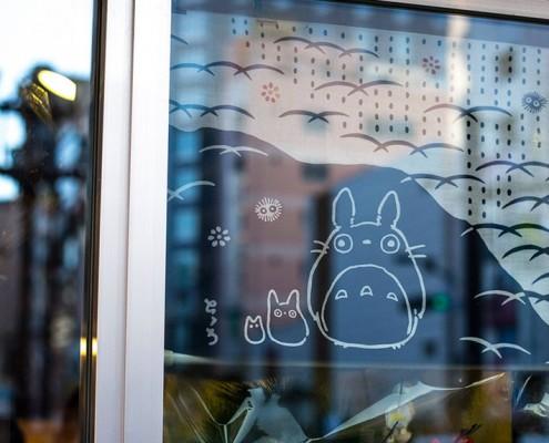 Studio Ghibli's Totoro adorns a store window in Asakusa