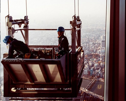 Window cleaners working on the tallest tower in the world