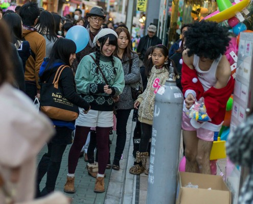 Kids lining up waiting for some balloons in Harajuku